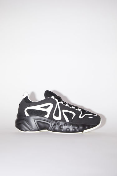 Acne Studios black/white logo print lace-up sneakers have organic, graphic soles.