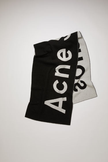 Acne Studios Toronty Logo Contrast black/white scarf is crafted from a soft wool blend with a double weave technique and features a bold logo lettering on both sides.