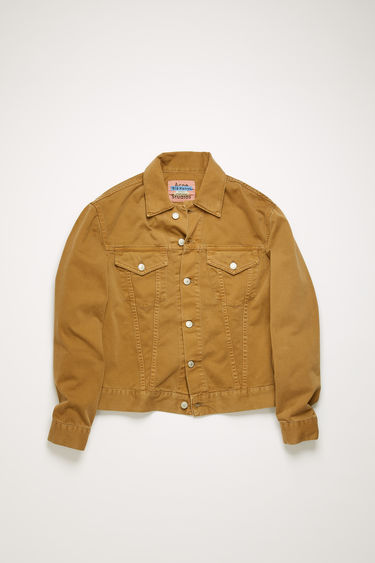 Acne Studios 1998 Camel Twill jacket is crafted from cotton twill that's garment dyed to add softness and give a lived-in appeal. It's cut to a slim silhouette and accented with chest patch pockets and logo-embossed metal buttons.