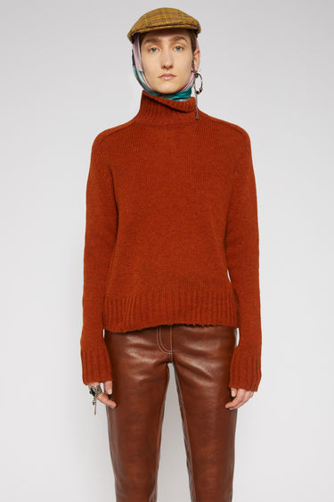 Acne Studios rust orange sweater is knitted from Shetland wool that's brushed on the interior for a softer handle. It features a high ribbed neckline, fully fashion shoulders and slightly rounded sleeves.