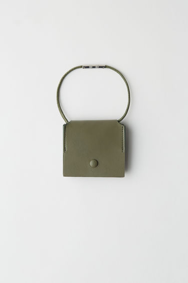 Acne Studios dark green coin purse is a snap button purse with a thin, removable leather shoulder strap.
