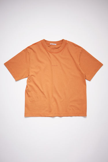 Acne Studios dusty orange short sleeve t-shirt features a ribbed crew neck and an Acne Studios logo at the chest.