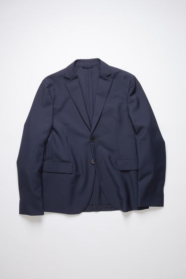 Acne Studios navy single-breasted suit jacket is made of a wool/mohair blend and features a classic fit.