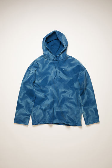 Acne Studios deep blue hooded sweatshirt is made from organic cotton and spray-painted like a tie-dye design. It's cut for an oversized fit and has slightly flared sleeves and a raised logo across the chest. The pattern and colour of this item may slightly differ from the images shown.