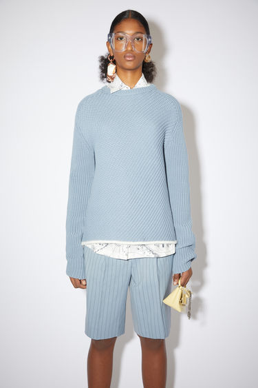 Acne Studios steel blue crew neck sweater is made of a chunky, bias rib knit with a relaxed fit.