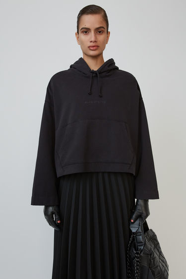Acne Studios Joghy black hooded sweatshirt is shaped for an oversized fit and accented with an embossed logo.