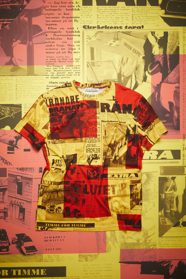 Acne Studios yellow/red crew neck t-shirt is made of cotton, featuring a Stockholm Syndrome newspaper print.