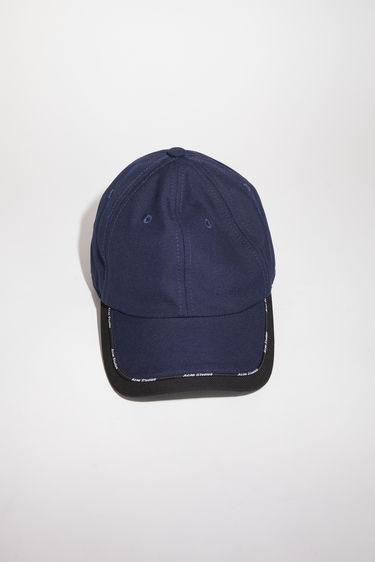 Acne Studios navy/black baseball cap has a classic six panel design, featuring logo piping along the contrasting brim.
