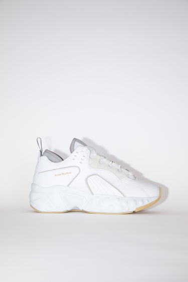 Acne Studios Manhattan Nappa white sneakers takes cues from '90s American urban sportswear. They are crafted to a bulky silhouette with a lace-up front and set on a sculpted platform sole. The size runs larger, please take a size smaller than usual.
