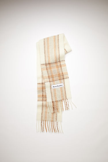 Acne Studios beige tartan check scarf is made of an alpaca blend with fringed ends.