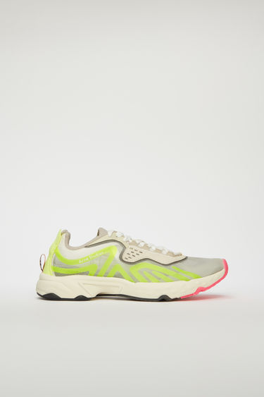 Acne Studios white/yellow sneakers feature a combination of running and trail elements in one silhouette. Crafted from ripstop with faux suede overlays, they're set on cushioned soles and accented with fluorescent trims.