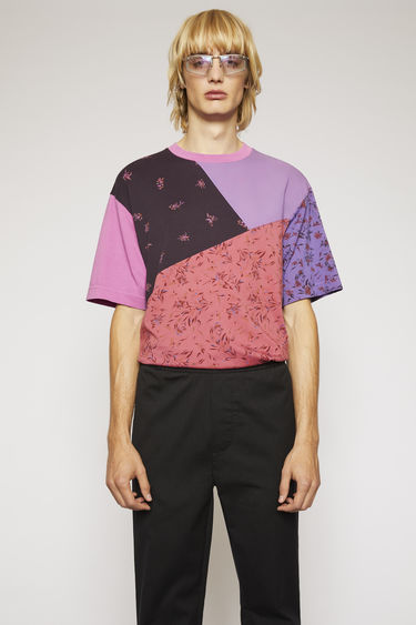 Acne Studios magenta pink t-shirt is crafted from a lightweight cotton jersey and features three different floral prints in a patchwork construction.