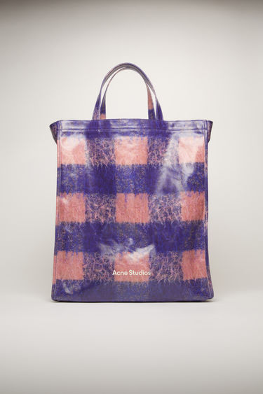 Acne Studios blue/pink tote bag is crafted from coated cotton for a glossy finish. It's patterned with checks and features a white logo print across the front.