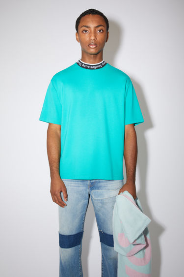 Acne Studios fern green t-shirt is made of a viscose blend with logo binding at the crew neck.