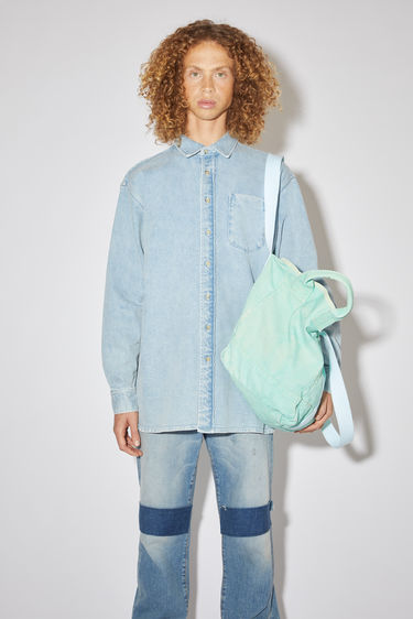 Acne Studios light blue oversized shirt is made of comfort stretch denim with a relaxed fit.