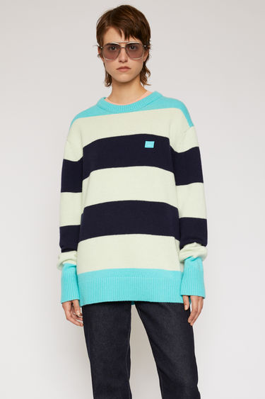 Acne Studios multi turquoise sweater is knitted from pure wool to an oversized fit and features a block stripe design.