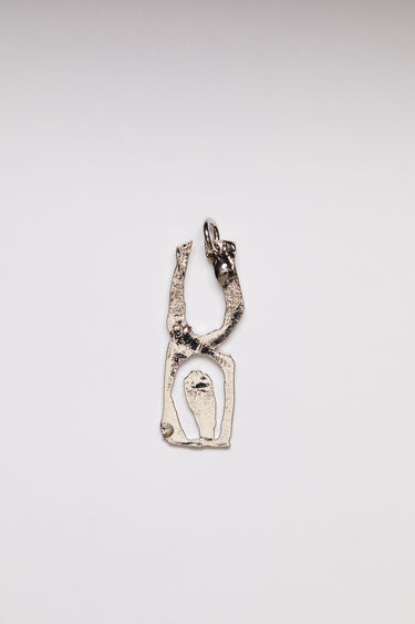 Acne Studios pendant is crafted from a hammered silver-tone brass and features a stencil of the letter 'U'  The pendant can be personalised with a chain necklace.