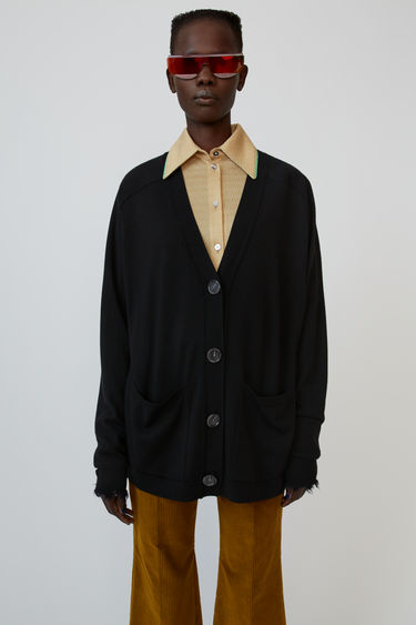 Acne Studios black wool cardigan is shaped with a deep V neckline and finished with fluffy trims on the cuffs.