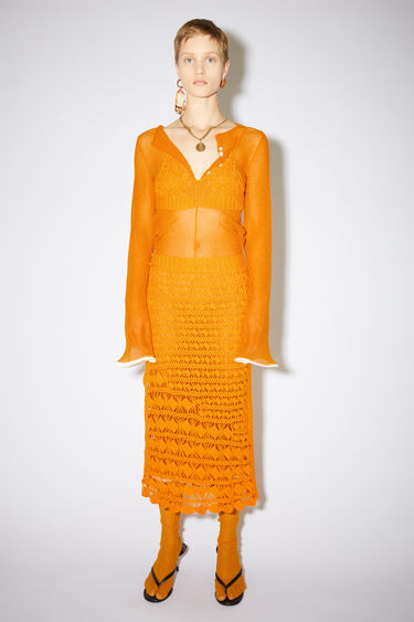 Acne Studios orange crochet skirt is made of cotton.