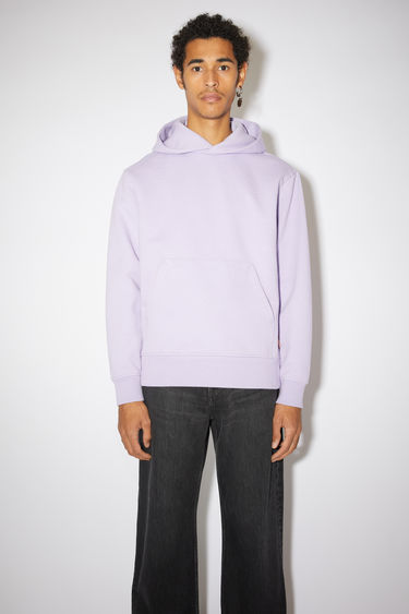Acne Studios light purple hooded sweatshirt is made from organically grown cotton and recycled polyester that's enzyme-washed for a soft handle and accented with a kangaroo pocket at the front.