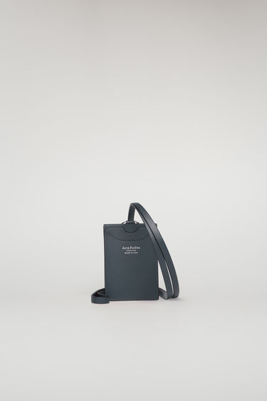 Acne Studios dark blue lanyard doubles as a cardholder - it's crafted from smooth leather and features four card slots and a logo-engraved ring clasp.