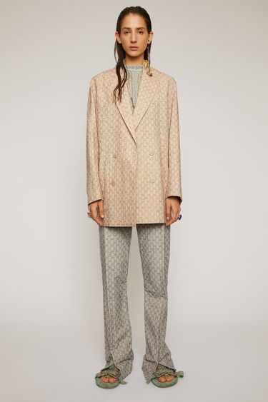 Acne Studios peach orange suit jacket is made from a cotton and linen blend that's jacquard-woven with a floral motif and shaped to a double-breasted silhouette with dropped shoulder seams.