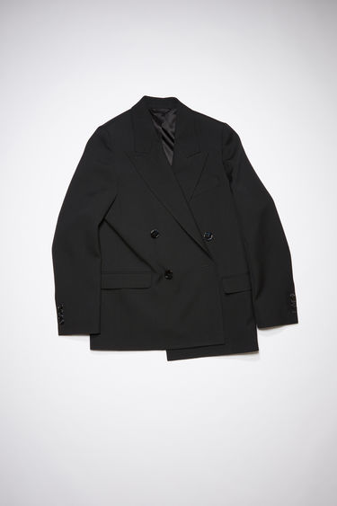 Acne Studios black double-breasted suit jacket is made of a wool blend with a classic fit.