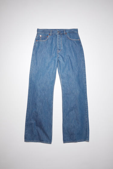 Acne Studios 2021M dark blue trash jeans are made from from rigid denim with a mid rise and a loose leg, cut to a relaxed, bootcut silhouette.