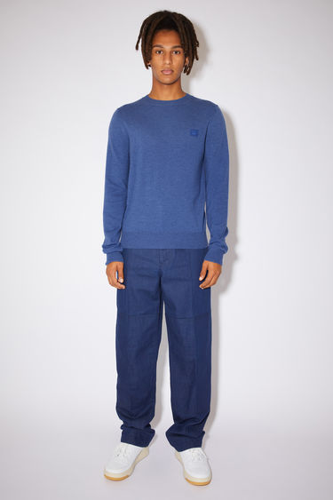Acne Studios dusty blue crew neck sweater is made from wool with a face logo patch and ribbed details.