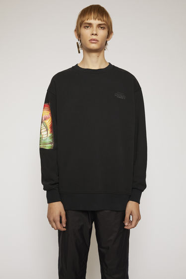 Acne Studios launches an exclusive capsule with Monster in My PocketⓇ. As part of the collaboration, this black sweatshirt is made from brushed jersey and features a Triton print on the right sleeve.