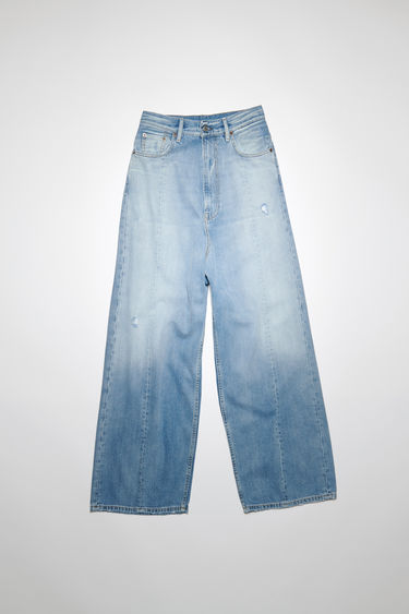 Acne Studios light blue jeans are crafted from soft tencel-blend denim that's stonewashed to give a worn-in appeal. They're shaped with a high-rise waistband, dropped crotch and loose, wide legs for a roomy and relaxed fit.