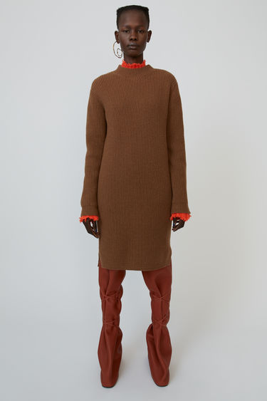 Acne Studios toffee brown dress is rib-knitted with wool blend and shaped with round neck and long sleeves.