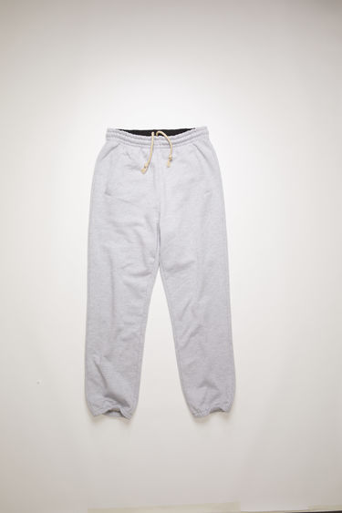 Acne Studios pale grey melange track pants are made from heavyweight brushed jersey and are shaped to a relaxed fit with an elasticated drawstring waistband.