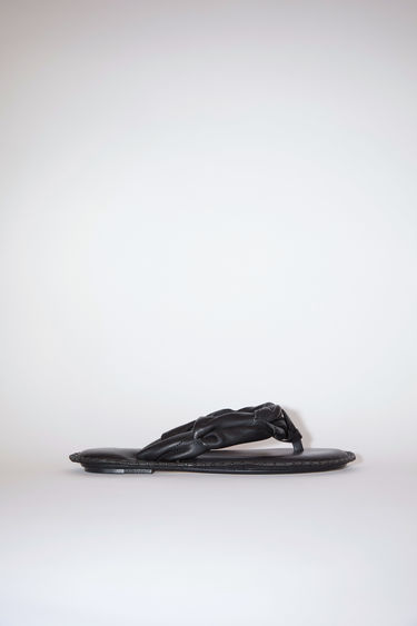 Acne Studios black sandals are made of calf leather.