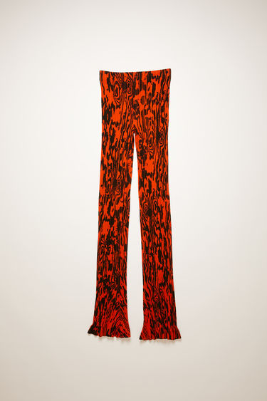 Acne Studios red/black trousers are crafted from ribbed mercerised-cotton jersey for a subtle sheen finish and printed all-over with a wood motif. They're shaped in a skinny-leg shape and finished with a frilled hem.