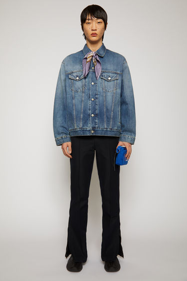 Acne Studios mid blue jacket crafted from stonewashed rigid denim to an oversized silhouette and features a point collar, two buttoned chest pockets and two side welt pockets.