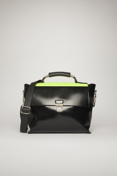 Acne Studios black satchel is crafted from high-shine leather and features an iridescent panel on the flap and a PU wrapped rope handle.