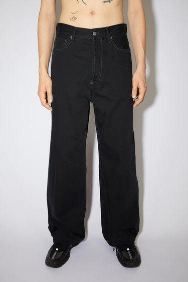 Acne Studios black jeans are made from from rigid denim with a deep rise and a loose leg.