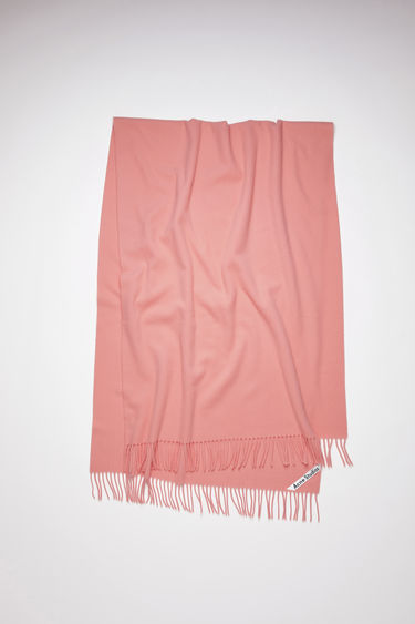 Acne Studios Canada New pale pink is an oversized wool scarf with fringed detailing.