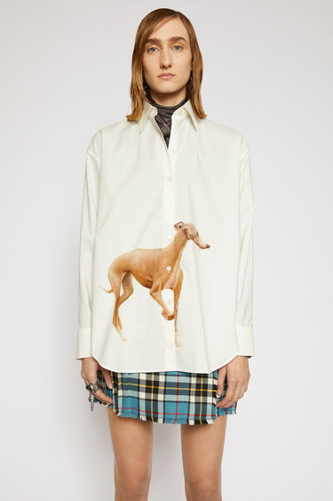 Acne Studios white/brown shirt is cut from cotton poplin to a relaxed shape with longer back hem and features a prize dog print created by British artist Lydia Blakeley.