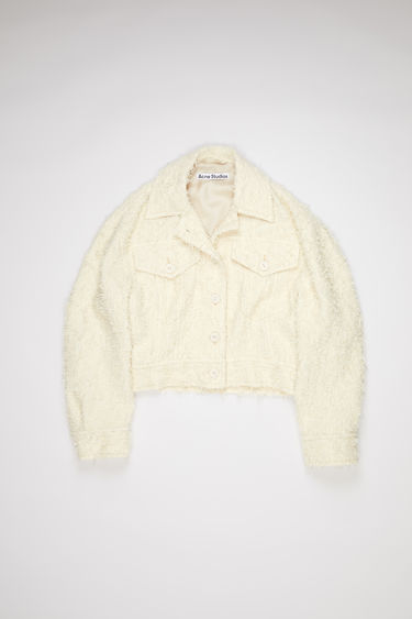 Acne Studios cream beige textured tweed jacket is made of a cotton blend with denim inspired details.