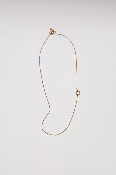 Acne Studios gold chain necklace can be personalised with the letter of your choice. The length of the necklace can be adjustable.