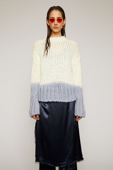 Acne Studios off white sweater is crafted from a soft alpaca and wool blend, and dip-dyed at the hem and cuffs for a two-tone effect.