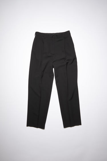 Acne Studios black pleated trousers are made of a wool blend with a classic fit.