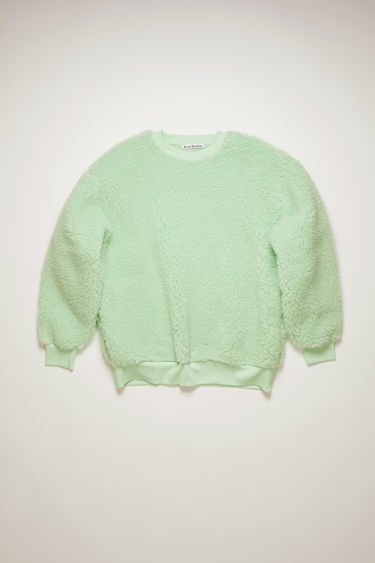Acne Studios pistachio green sweatshirt is crafted from heavy fleece to an oversized silhouette with ribbed trims and features mandala-inspired print at the back.
