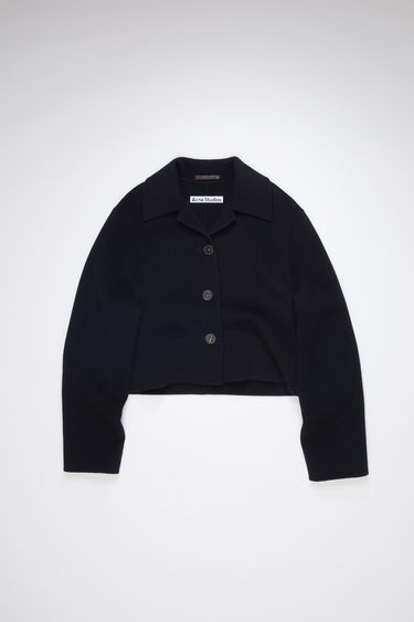 Acne Studios black unlined cropped jacket is made of wool with button closures.