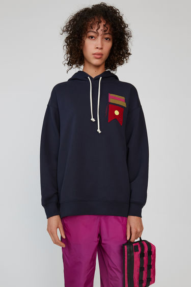 Acne Studios navy oversized hoodie with cotton canvas flag artwork and tonal face patch.