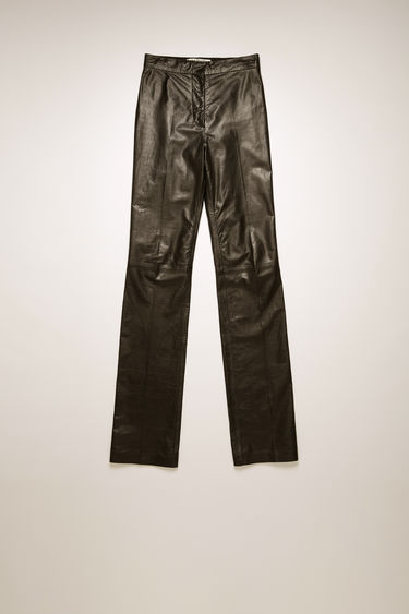 Acne Studios black leather trouser are cut to a high-rise waist with straight legs and feature stitched seams and pressed creases.