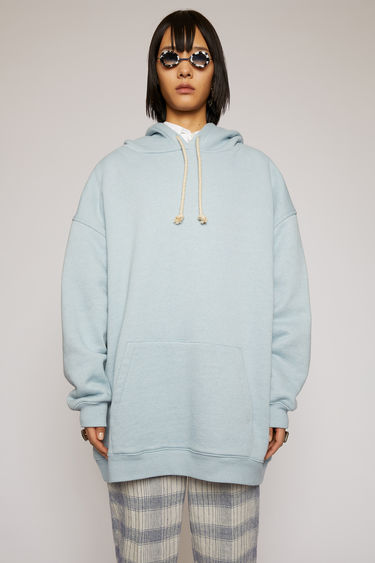 Acne Studios powder blue hooded sweatshirt is crafted for an oversized fit from midweight loopback jersey and adorned with a label patch that's left with loose thread for a subtle note of texture.