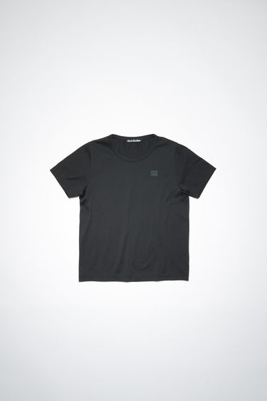 Acne Studios Mini Nash Face black t-shirt is shaped with a crew neck and short sleeves and finished with a tonal face-embroidered patch on the chest.